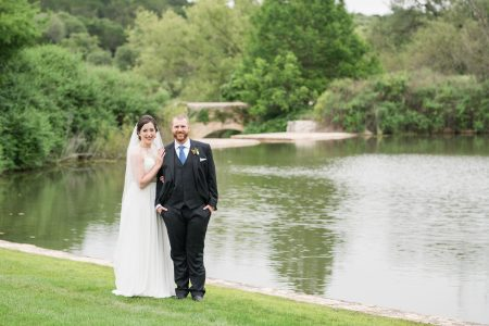 Taylor + Tom - Posed in front of the pond with lush green trees behind