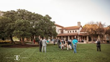 Guests mingling during cocktail hour on the back patio and Event Lawn featuring beer burros