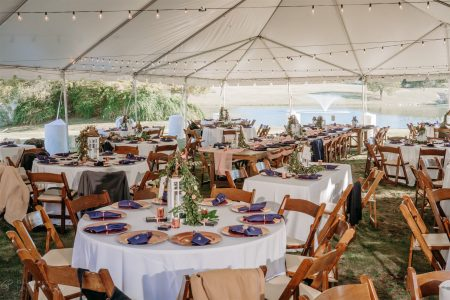 View of the reception underneath the tent on the Event Lawn at Garey House