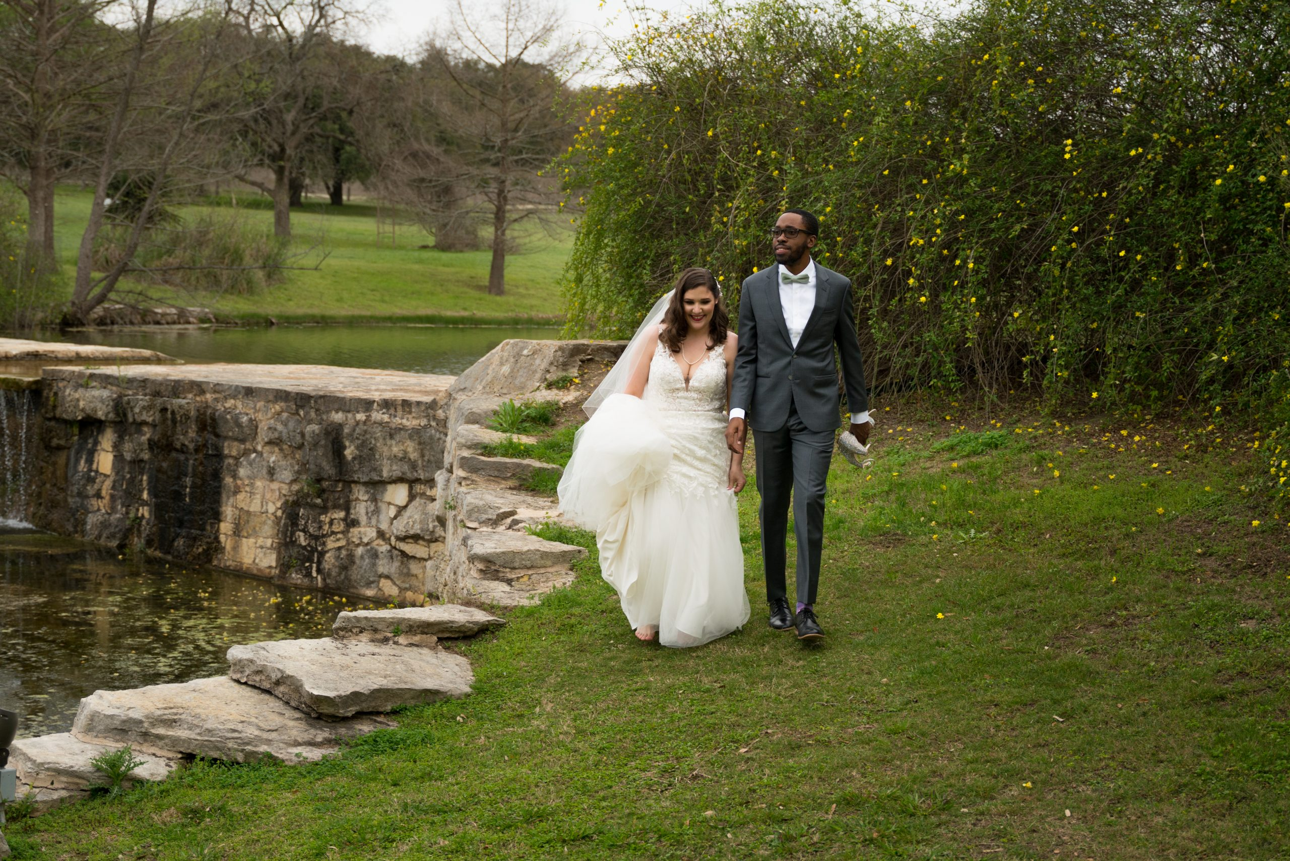 Elizabeth+Derek - Bride and Groom along the edge of the pond in March