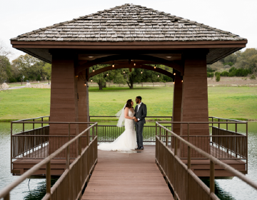 ELOPEMENTS - Bride and Groom posed on the dock over the pond at Garey House